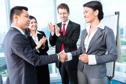 Business partners shake hands