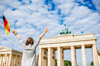 Young woman standing in front of Brandenburg Gate
