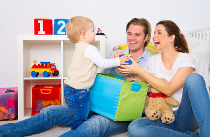 Parents play with their child at home