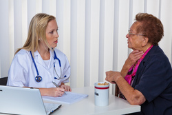 Physician talks with patient