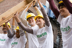 Volunteers build together