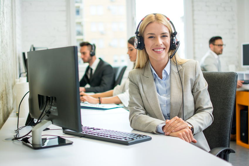 Woman with headset sitting at office desk