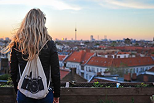 Woman from behind and panoramic view over a city